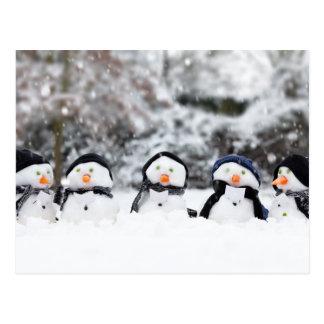 Five cute snowmen facing forward postcard
