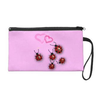 Five little ladybugs and two hearts on pink wristlet purse