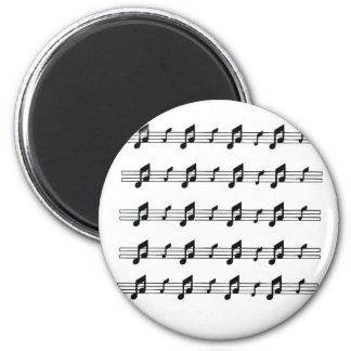 Five music staves with notes bw refrigerator magnets