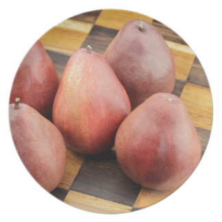Five Red Pears on a Wooden Chessboard Dinner Plate