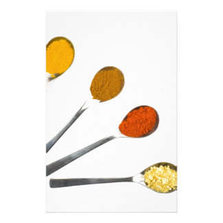 Five seasoning spices on metal spoons stationery
