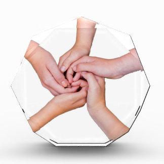 Five teenage arms with hands entangled acrylic award