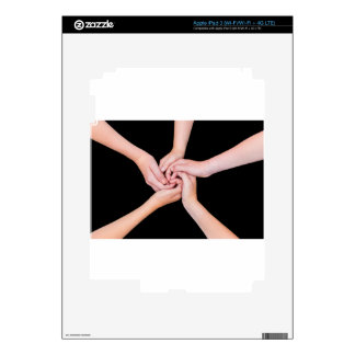 Five teenage arms with hands entangled on black skins for iPad 3