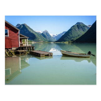 Fjord landscape with boathouse and mountains postcard