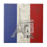 "Flag and Symbols of France ID156 Tile<br><div class=""desc"">This patriotic ceramic tile design features the flag of France overlaying images of The Eiffel Tower,  Arc de Triomphe,  and a sample of fine French wine...  all with a modern,  distressed effect. Search ID156 to see other products with this design.</div>"