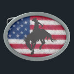 "Flag Bucking Horse Belt Buckle<br><div class=""desc"">A black silhouetted bucking horse and cowboy superimposed over a distressed American flag is the image on this belt buckle.</div>"