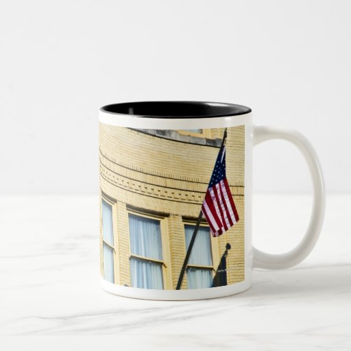 Flag hanging from a building, San Antonio, Mugs