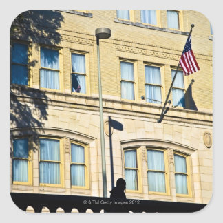 Flag hanging from a building, San Antonio, Square Sticker