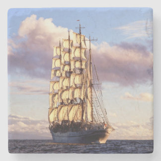 Flag ship setting sail at sea stone coaster