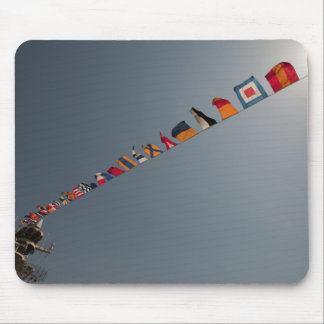 Flags fly over the deck of the USS Iwo Jima Mouse Pad