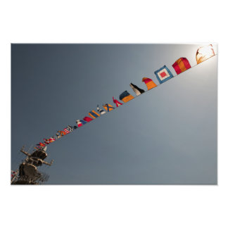 Flags fly over the deck of the USS Iwo Jima Photo Print