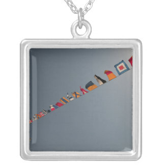 Flags fly over the deck of the USS Iwo Jima Silver Plated Necklace