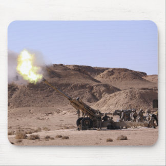 Flame and smoke emerge from the muzzle mouse pad