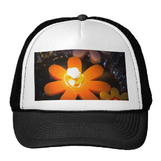 Flame from an orange floating candle mesh hat