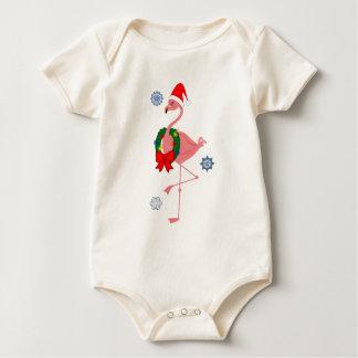 Flamenco con el gorra de Santa y la guirnalda del Mameluco