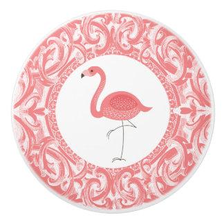 Flamenco rosado con el ornamento floral de los pomo de cerámica