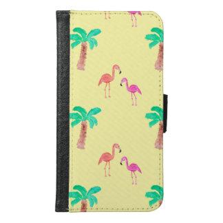 Flamencos rosados con las palmeras tropicales
