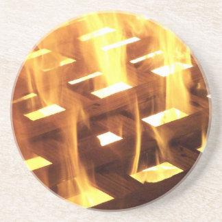 Flames of fire through a lattice photograph design drink coaster