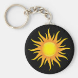 Flaming sun on a black background keychain