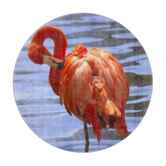 Flamingo on one leg in water cutting board