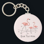 "Flamingo Pink Trio 2 Text key chain<br><div class=""desc"">Stylish design with a retro touch featuring a flamingo and stars on a pink background. A customizable design for you to personalise with your own text,  images and ideas. An original digital art image created by QuirkyChic.</div>"