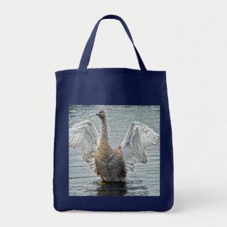 Flapping, Preening Mute Swan and Lake Photo Tote Bag