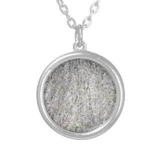 Flat surface of a gray granite stone silver plated necklace