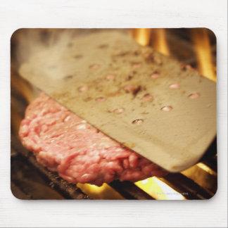 Flattening a Hamburger Patty with a Spatula on Mouse Pad