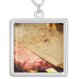 Flattening a Hamburger Patty with a Spatula on Square Pendant Necklace