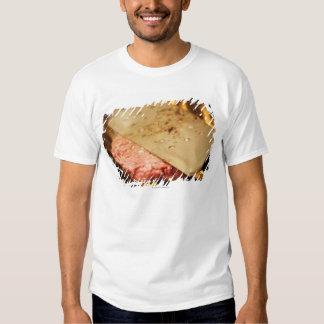 Flattening a Hamburger Patty with a Spatula on Tee Shirt