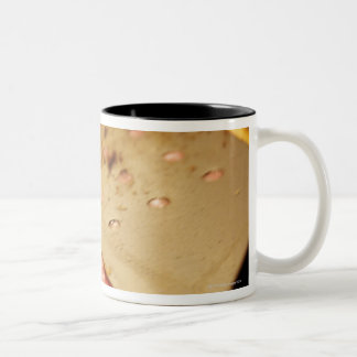 Flattening a Hamburger Patty with a Spatula on Two-Tone Coffee Mug