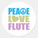 Flauta del amor de la paz etiqueta redonda
