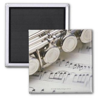 Flauta en partitura iman de nevera