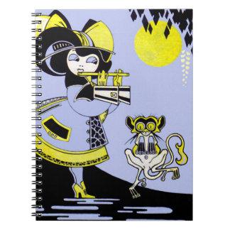 Flautista y el mono libro de apuntes
