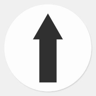 flecha negra encima del icono pegatina redonda