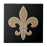 """Fleur de Lis Gold with White and Black Outline Ceramic Tile<br><div class=""""desc"""">The fleur-de-lis or fleur-de-lys (plural: fleurs-de-lis) is a stylized lily (in French,  fleur means flower,  and lis means lily) or iris that is used as a decorative design or symbol. It may be &quot;at one and the same time,  political,  dynastic,  artistic,  emblematic,  and symbolic&quot;,  especially in heraldry.</div>"""