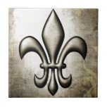 "Fleur-De-Lis V1 Tile<br><div class=""desc"">Fleur-De-Lis V1 by Roz Abellera. Fleur De Lis metallic design against a metallic background. Gold swirls were also added subtly in the background for effect. See this design on a variety of products.</div>"