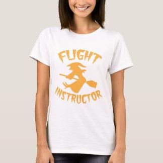 Flight instructor in orange Halloween flying witch T-Shirt