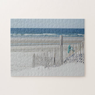 Flip flops on the beach fence jigsaw puzzle