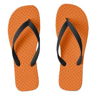 Flips-flopes anaranjados con los puntos azul