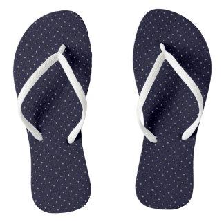 Flips-flopes azul marino con los puntos de oro