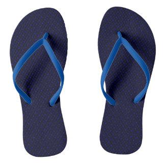 Flips-flopes azul marino con los puntos del azul