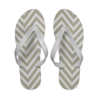 Flips-flopes blancos de las correas del zigzag de