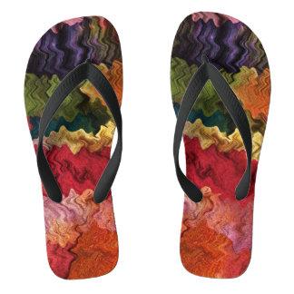 Flips-flopes coloridos del extracto de la tela