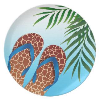Flips-flopes de la playa tropicales plato de cena