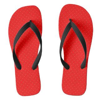 Flips-flopes rojos con los puntos de oro