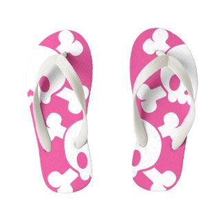 Flips-flopes rosados del verano de los cráneos del