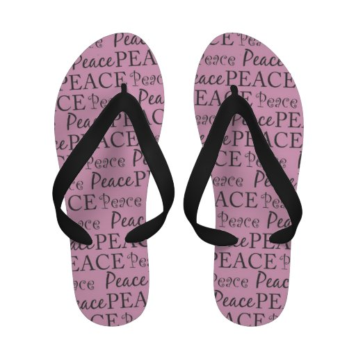 Flips-flopes rosados y negros de la paz