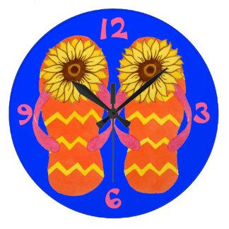 Flips-flopes y reloj del verano de los girasoles