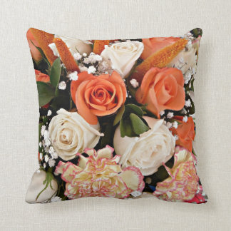 Floaral orange and white roses with cream carnatio pillows